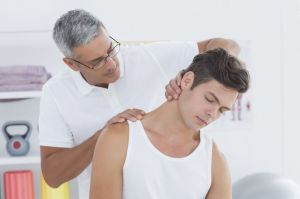 neck-pain-doctor-stretching-therapist-wavebreakmedia-istock_000068946871_medium